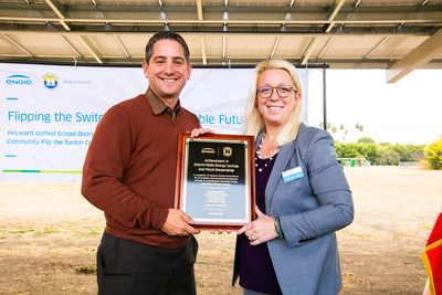 Hayward USD Superintendent Dr. Matt Wayne and ENGIE VP Courtney Jenkins celebrate Hayward USD's sustainable energy program, 2019.