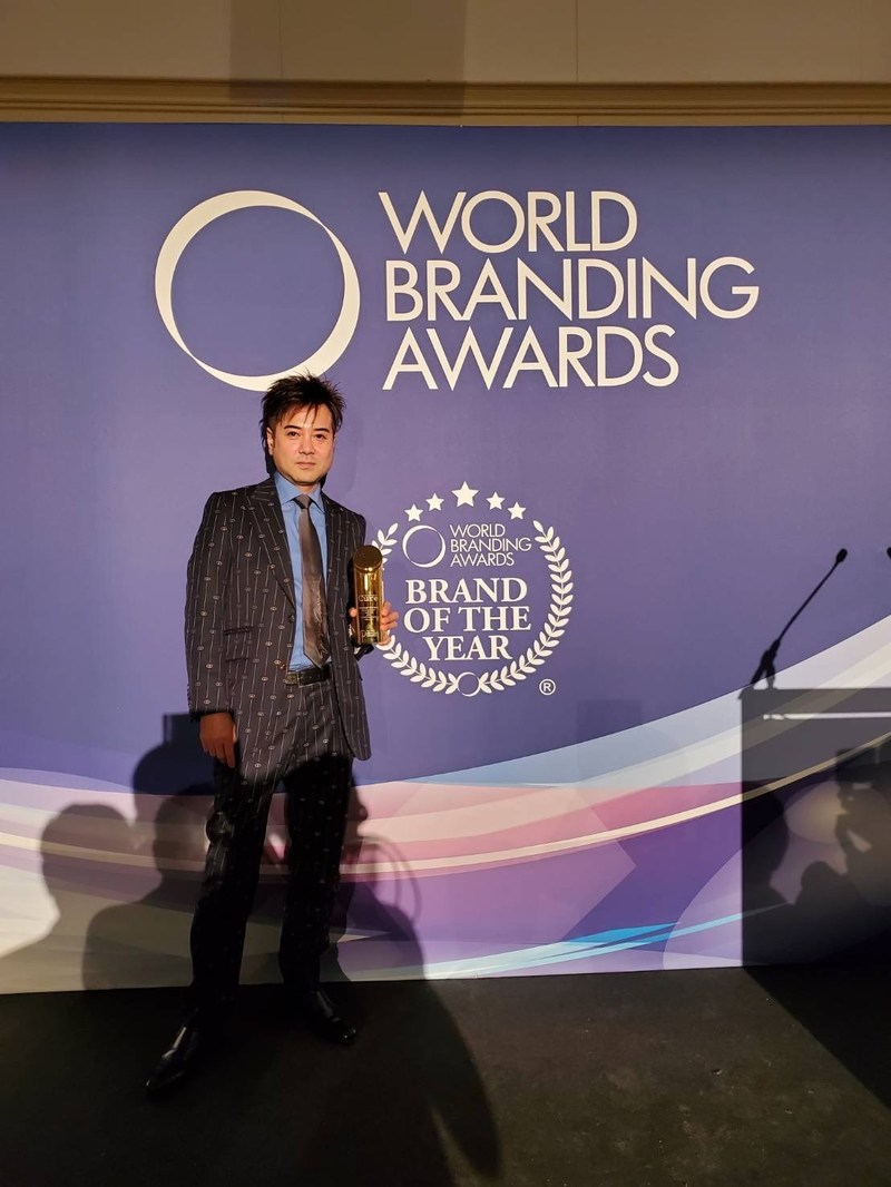 "Koji Kamoda, CEO of Toyo Life Service International Inc. accepts the 2019 ""Brand of the Year Award"" in the Health and Beauty Category at the World Branding Awards"