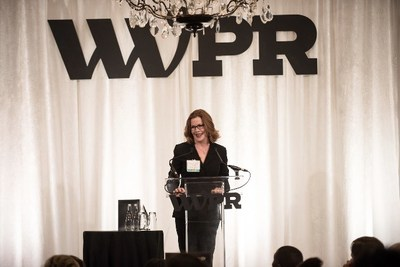Maura Corbett, Chief Executive Officer and Founder, Glen Echo Group, accepts the 2019 WWPR Woman of the Year Award.