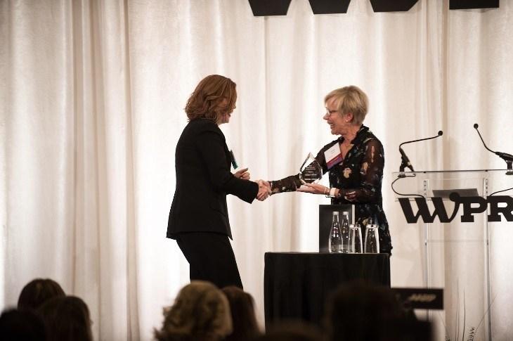 2018 WWPR Woman of the Year Award winner Wendy Hagen, President of hagen, inc, presents Maura Corbett, Chief Executive Officer and Founder, Glen Echo Group, with the 2019 WWPR Woman of the Year Award.