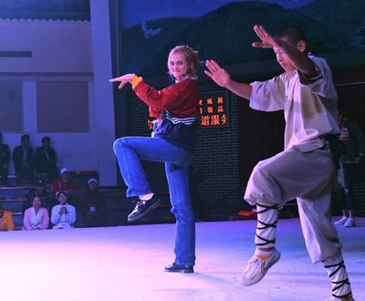 A competitor learned Kungfu from Shaolin monks in the Martial Arts Hall of Shaolin Temple.