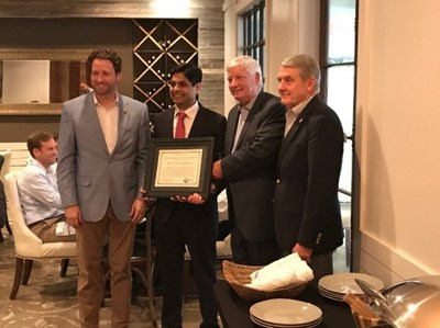 Dr.Ghatnekar (second from left) of Firststring Research receives a Certificate of Recognition for research on traumatic cell injuries.  Congressman Cunningham (far left), Mr. Howell (second from right), and LTG (Ret.) Thompson (right) presented the certificate at Monday's luncheon.