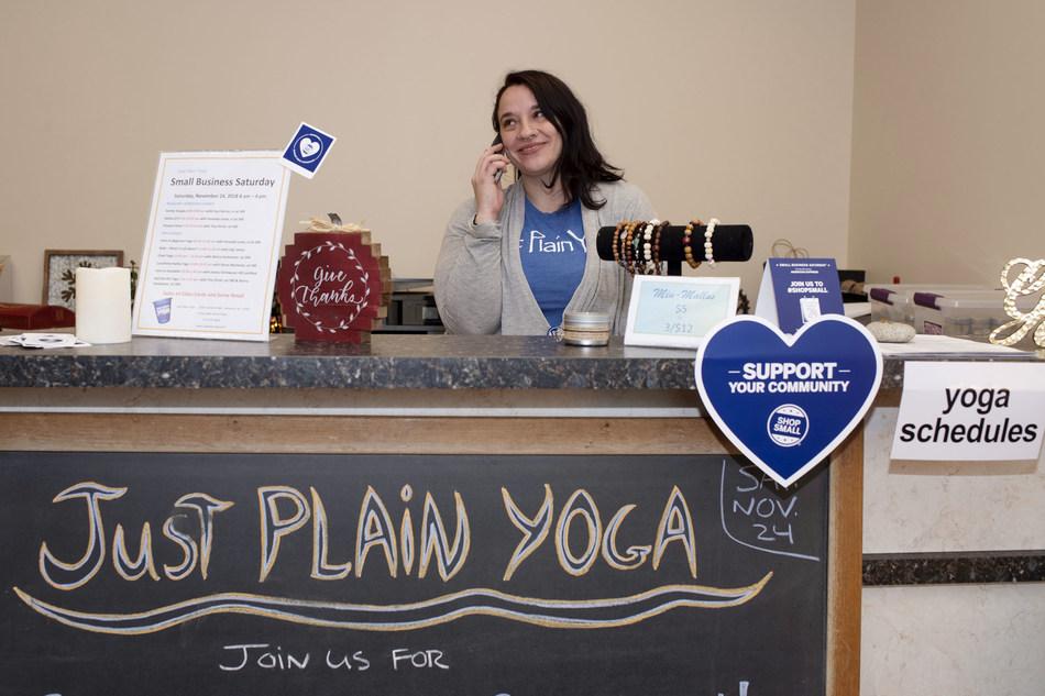 A Just Plain Yoga Studio team member answers the phone during the 2018 Small Business Saturday event. Just Plain Yoga Studio is located in the West Shore Plaza at 1200 Market Street, Lemoyne, Pennsylvania.