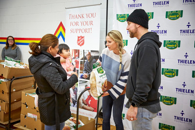 Adam and Caitlin Thielen distributing turkeys.
