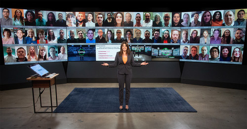 In-studio moderator in front of Pando video wall displaying remote participants