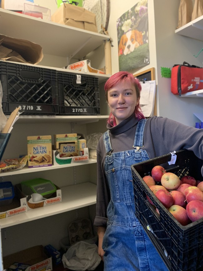 Jess (Food Security Coordinator) in the Head & Hands Food Pantry (CNW Group/Head and Hands)