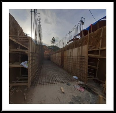Construction of the tunnel and retaining wall for the crushing circuit (CNW Group/TVI Pacific Inc.)