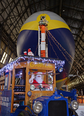 The Goodyear Blimp and the U.S. Marine Corps Reserve Toys for Tots welcome Santa to greet guests donating toys to the program.