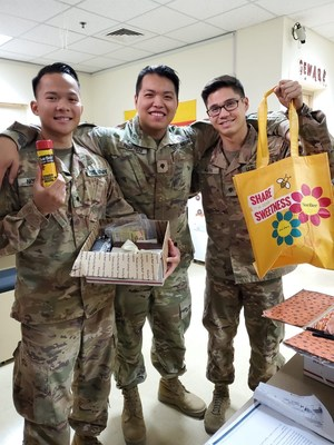 Military members receiving Sue Bee honey packages.