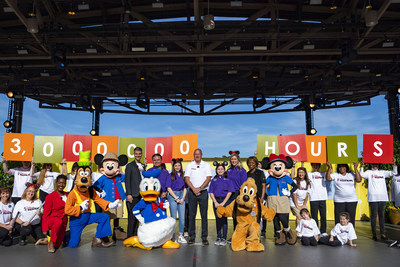 """The Walt Disney Company and Points of Light honored the """"Volunteer Family of the Year"""" at Disney Springs at Walt Disney World Resort, Nov. 23, 2019, in Lake Buena Vista, Fla. During an inspiring ceremony, thousands of guests and Disney Cast Members celebrated the Aguirre family of McAllen, Texas (purple shirts), along with Disney Parks, Experiences and Products Chairman Bob Chapek (center), Walt Disney World Resort President Josh D'Amaro (right of Mickey Mouse), Points of Light CEO Natalye Paqui"""
