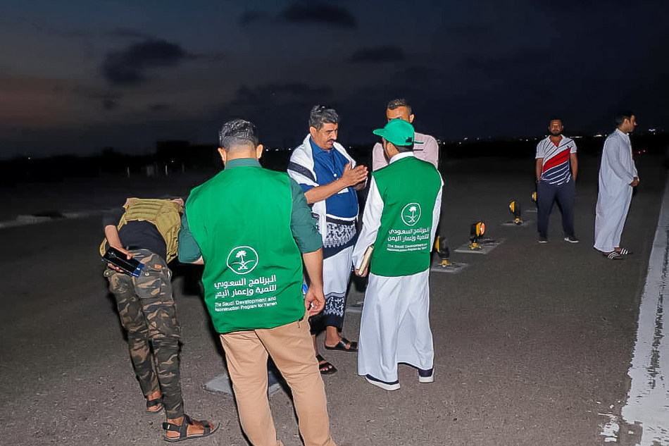 Officials of the Saudi Development and Reconstruction for Yemen (SDRPY) inspect a runway at Aden International Airport