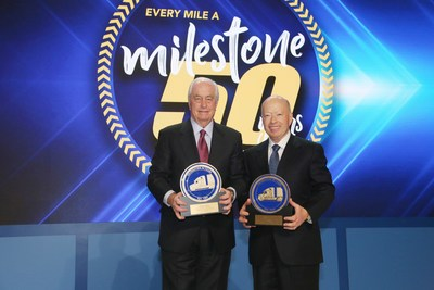 Roger S. Penske, left, Chairman of Penske Transportation Solutions, and Brian Hard, President and CEO of Penske Transportation Solutions, pose for a 50th anniversary photo.