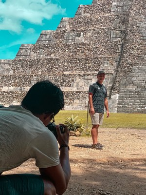 """A Beautiful Game,"" has found itself being filmed in numerous iconic locations. Evans is seen here filming at Chichen Itza, known as one of the Seven Wonders of The World in Mexico. Evans became the second solo artist to film there, with singer Jennifer Lopez being the first. (PRNewsfoto/Thematic Productions)"