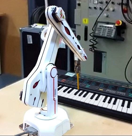 The first of a dozen ST12 articulated robots purchased by Rose-Hulman Institute of Technology played music on a keyboard