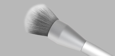 2-in-1 Makeup Brush A. Larger brush head pictured and best used for foundation and loose powder application.