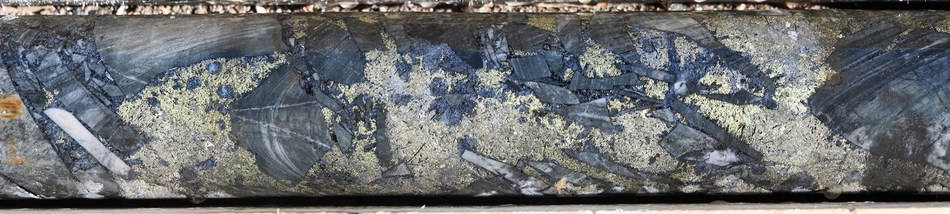 Figure 5: Typical breccia mineralisation: Tourmaline-altered siltstone clasts set in a pyrite-chalcopyrite matrix.  SFDH-002, 104m. From a 1m sample that averaged 4.6 g/t gold, 229 g/t silver and 0.91% copper. (CNW Group/Turmalina Metals Corp.)
