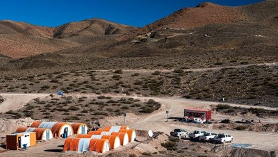 Figure 1 - San Francisco Project area: temporary company camp in foreground and drill rigs at the San Francisco del Los Andes breccia pipe in background. The project is located in an arid, sparsely populated area at an elevation of ~2600m. The camp is located 20km by unsealed road to the nearest public road and the state power grid. (CNW Group/Turmalina Metals Corp.)
