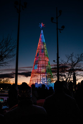 Spectators watch the official inaugural lighting of Denver's Mile High Tree, the city's newest free holiday attraction. Located in Sculpture Park, the seven-story tall, 39-foot diameter conical structure features more than 60,000 LED lights choreographed to nightly, multi-cultural music shows. (Credit Nikki A. Rae Photography).