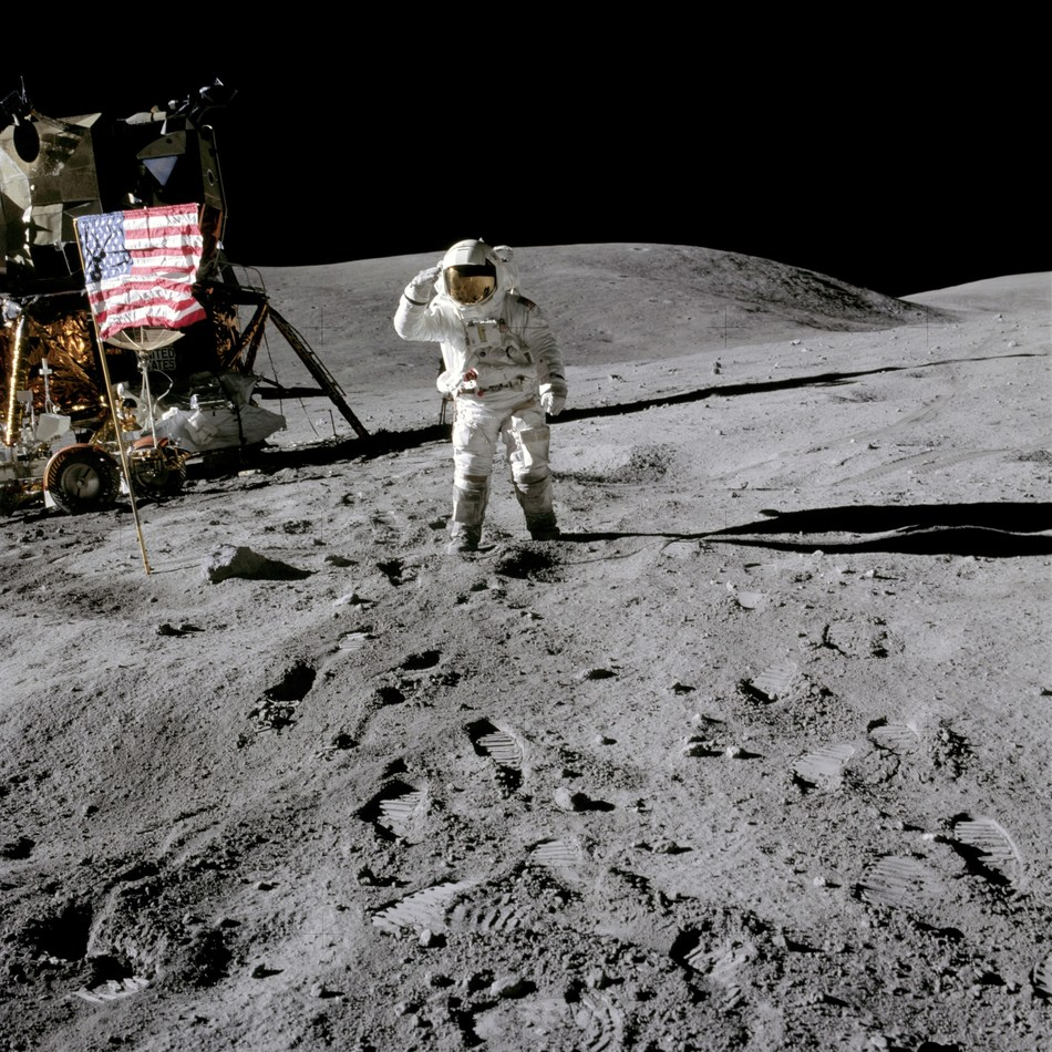April 21, 1972 - Astronaut Charles M. Duke Jr., Apollo 16 lunar module pilot, salutes the United States flag during the mission's first extravehicular activity.