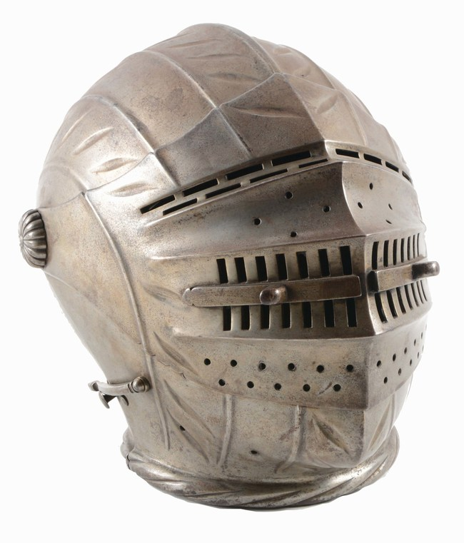 Maximilian-type closed helmet in the style of 1540, finely fluted one-piece skull and forged/pierced visor. Possibly of the period. Estimate $5,000-$8,000