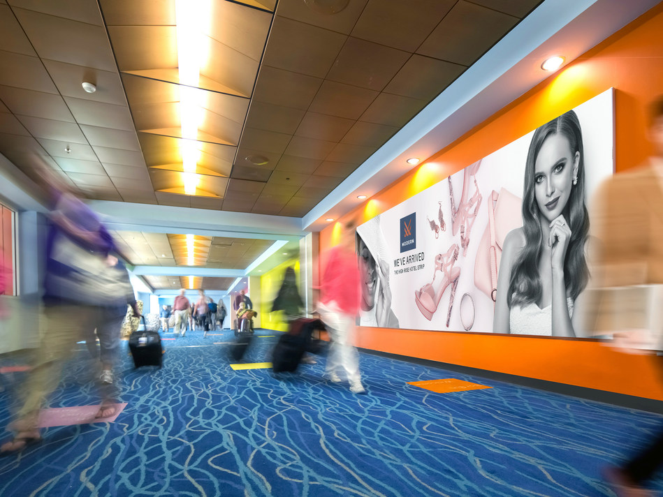 Clear Channel Airports' new media program at Queen Beatrix International Airport will include upgraded digital, experiential and high-impact illuminated tension fabric displays like the one pictured here.