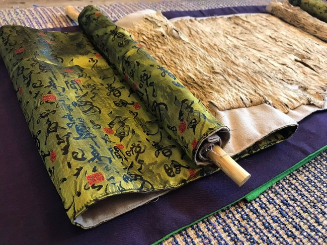 Signature cloth made of bark sheets and reused fabric