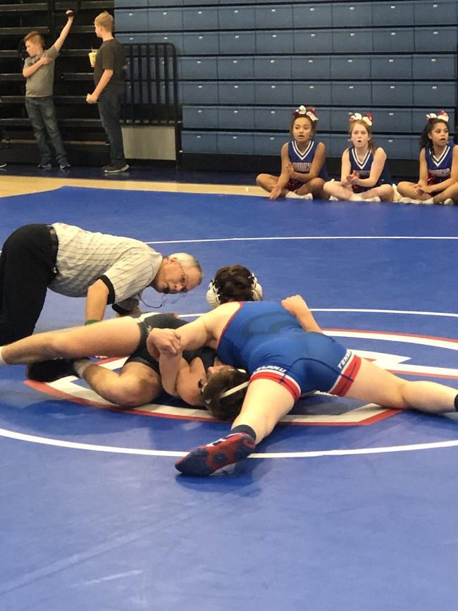 Piper Fowler pins an opponent during a match.