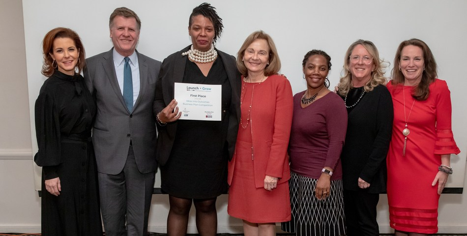 Launch + Grow business plan competition first place winner Adriane Mack (center) pictured with judges Stephanie Ruhle, Joe Kernen, Ellen R. Alemany, Toya Williford and Operation HOPE's Mary Erhsam.
