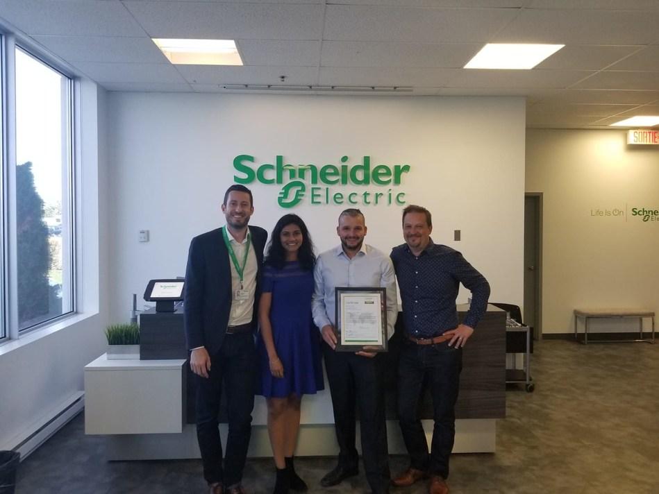 Gaetan Djenane and Lakmini Perera of Schneider Electric Canada with Florent Mecca of Consult-Elect, and Ludovic Debuchy of Schneider Electric Canada. (CNW Group/Schneider Electric Canada Inc.)