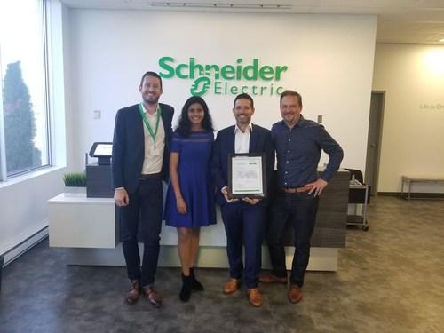 Gaetan Djenane and Lakmini Perera of Schneider Electric Canada with Nick Folino of McRae Electric Ltd., and Ludovic Debuchy of Schneider Electric Canada. (CNW Group/Schneider Electric Canada Inc.)