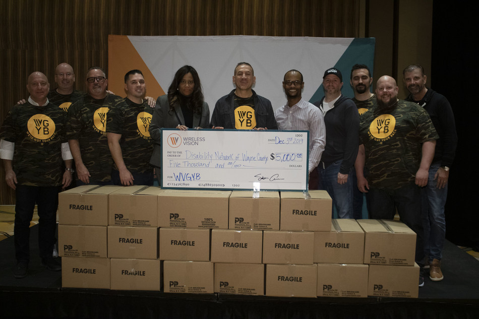 Wireless Vision donates 700 hygiene kits and a check for $5,000 to the Disability Network Wayne County Detroit. Included is Saber Ammori, CEO of Wireless Vision, Lori Hill, Exec. Director, Disability Network Wayne County Detroit, along with Wireless Vision executives and WV military veteran staff.
