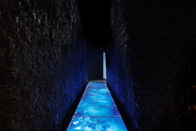 The Crevasse: Immersive entryway made up of digital glass flooring and active sensors detecting footsteps across the display, simulating walking over cracking ice. (CNW Group/Canada Goose)