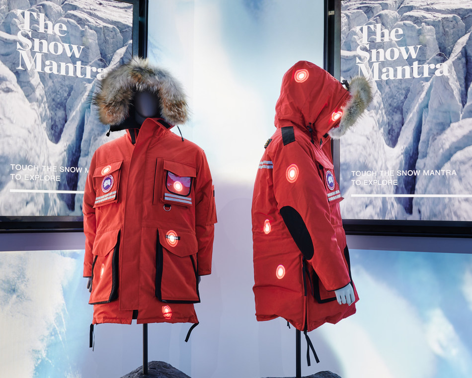 "Interactive Jackets: Digital ""hotspots,"" allow guests to explore specific functions and features of the iconic Snow Mantra parkas. (CNW Group/Canada Goose)"