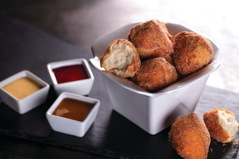 This December, P.F. Chang's is introducing Bao Donuts. This new dessert is rolled in cinnamon sugar with miso-caramel, raspberry, and coffee-vanilla dipping sauces.