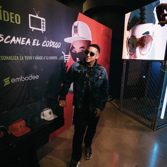 "At the recently opened ""El Jefe"" Daddy Yankee Museum, the music star shows off his limited-edition hats that fans can customize at his new online shop, powered by Embodee."