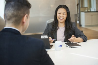 Rachel Suh of Mattamy Homes meets with a colleague at the company's Milton office. (CNW Group/Mattamy Homes Limited)