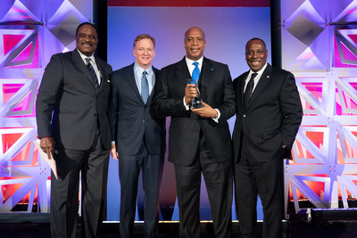 """Kevin Warren, Commissioner-Elect of the Big Ten Conference receives the GENYOUth Vanguard Award from NFL Commissioner Roger Goodell, CBS Sportscaster James """"J.B."""" Brown and Steven Williams, President of PepsiCo Foods North America at the organization's recent Gala in New York City. GENYOUth raised nearly $2 million to create healthier school communities at its annual fundraiser which was held at New York City 's Museum of Natural History."""