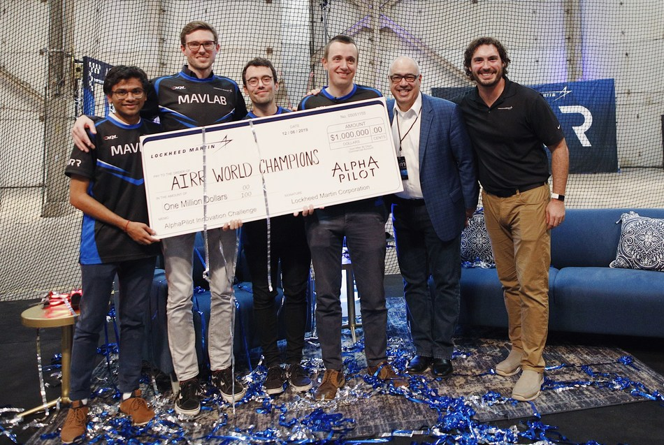 AIRR World Champions, Team MAVLab, receive $1mm cash prize from Lockheed Martin SVP of Communications, Dean Acosta, and AlphaPilot Program Manager, Keith Lynn.