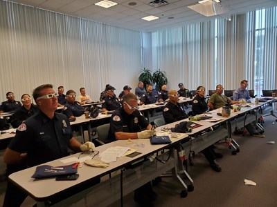 Long Beach firefighters participate in SCAN's Trading Ages senior sensitivity workshop.