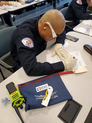 Long Beach firefighter tries to fill out paperwork with vision impairments and joint sensitivity.