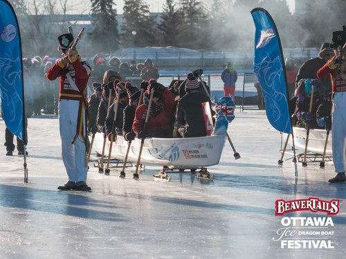 Members of the 100th Regiment of Foot fire a shot to start an ice dragon boat race on the Rideau Canal Skateway in Ottawa. (CNW Group/Ottawa Ice Dragon Boat Festival)