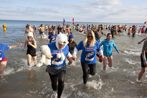 Hundreds of dippers and thousands of spectators will brave the cold temperatures on New Year's Day at the Courage Polar Bear Dip with proceeds going to World Vision clean water initiatives. Source: World Vision Canada (CNW Group/World Vision Canada)