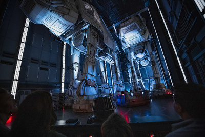 Guests race past massive AT-AT walkers aboard a First Order Star Destroyer as part of Star Wars: Rise of the Resistance, the groundbreaking new attraction now open inside Star Wars: Galaxy's Edge at Disney's Hollywood Studios in Florida and opening Jan. 17, 2020, at Disneyland Park in California. (Matt Stroshane, photographer)