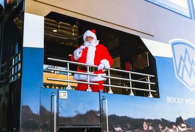 Santa enjoys Rocky Mountaineer's newest GoldLeaf rail car. Photo credit: Rocky Mountaineer. (CNW Group/Rocky Mountaineer)