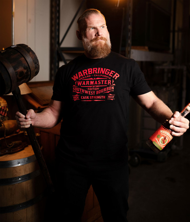 "Josh Barnett with Warmaster Edition Bourbon: Josh ""Warmaster"" Barnett holds a bottle of his exclusive single barrel, cask strength bourbon."