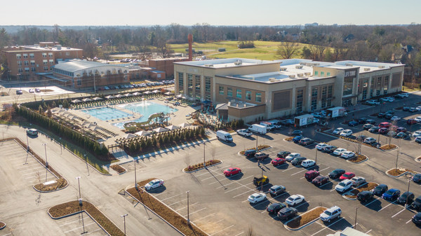 Exterior drone shot of Life Time Frontenac with the outdoor pool in the background