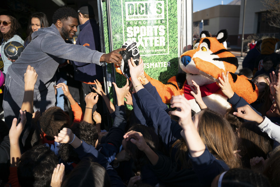 Football Hall of Famer LaDainian Tomlinson, Tony the Tiger and reps from The DICK'S Sporting Goods Foundation announced today that every public middle school in El Paso, TX will receive a Sports Matter grant--totaling $500,000--on behalf of Kellogg's Frosted Flakes' Mission Tiger and The DICK'S Sporting Goods Foundation's Sports Matter. The duo teamed to help give El Paso middle schoolers the chance to play sports, delivering truckloads of new equipment. (Jorge Salgado/AP Images for Kellogg's)