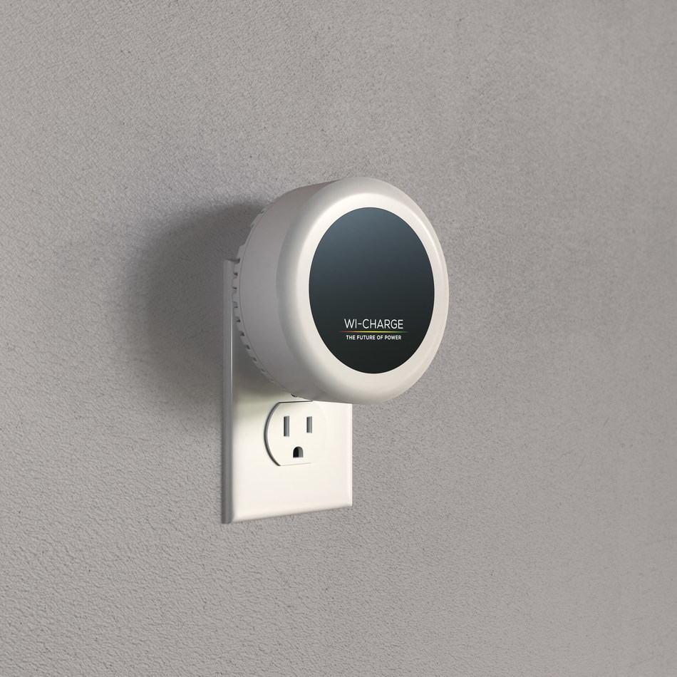 Wi-Charge PowerPuck long-range wireless charging system, installed in a US power outlet. The PowerPuck delivers power over distance, safely and efficiently, to a wide range of IoT and smart devices using invisible IR light.