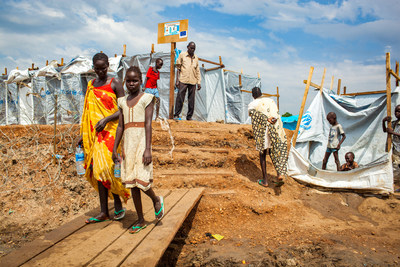 South Sudanese children walk around in a refugee camp