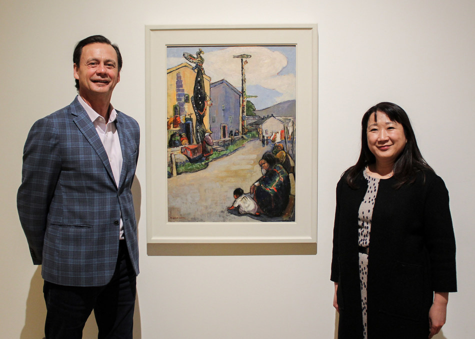 Director & Chief Curator, Dr. Curtis Collins and Kiriko Watanabe, Gail & Stephen A. Jarislowsky Curator alongside Emily Carr, 'Street, Alert Bay', 1912, oil on canvas, 81.3 x 59.4 cm; 32 x 23 3/8, Audain Art Museum Collection; Purchased with Funds from the Audain Foundation, 2019.013 (CNW Group/Audain Art Museum)